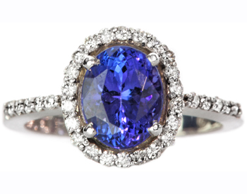 14K WHITE GOLD OVAL TANZANITE AND DIAMOND HALO RING