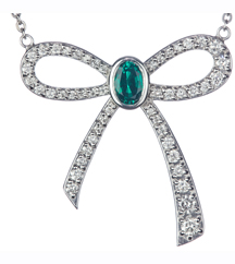 14K WHITE GOLD PAVE DIAMOND BOW AND OVAL EMERALD CENTER PENDANT