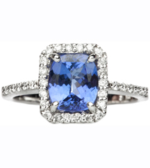 14K WHITE GOLD OVAL TANZANITE AND CUSHION PAVE DIAMOND HALO RING