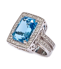 16.32CT EMERALD CUT BLUE TOPAZ AND DIAMOND RING