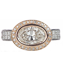 14K ROSE GOLD AND WHITE GOLD OVAL SHAPED DIAMOND RING