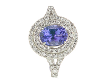 18K WHITE GOLD OVAL TANZANITE AND DOUBLE HALO DESIGN RING